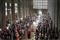 <p>Meghan Markle and her bridal party walk down the aisle of St George's Chapel at Windsor Castle for the wedding. (Danny Lawson – WPA Pool/Getty Images) </p>
