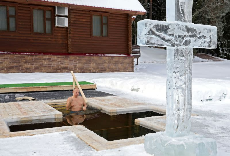 Russian President Putin takes a dip in icy waters during celebrations of the Orthodox Christian feast of Epiphany in Moscow Region