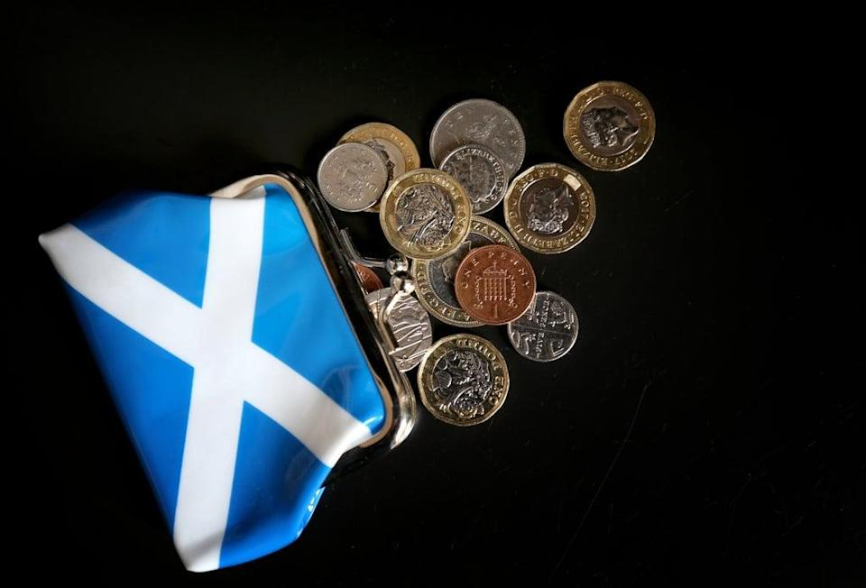 An independent Scotland could face spending cuts or tax rises 'before too long' – whichever currency position it adopts, a think tank claims (Jane Barlow/PA)