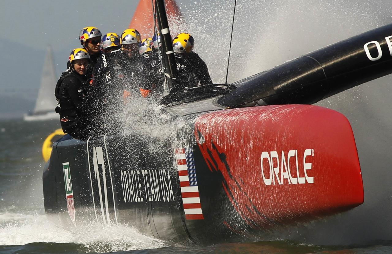 Oracle Team USA sails to victory against Emirates Team New Zealand during Race 18 of the 34th America's Cup yacht sailing race in San Francisco, California September 24, 2013. REUTERS/Robert Galbraith (UNITED STATES - Tags: SPORT YACHTING)
