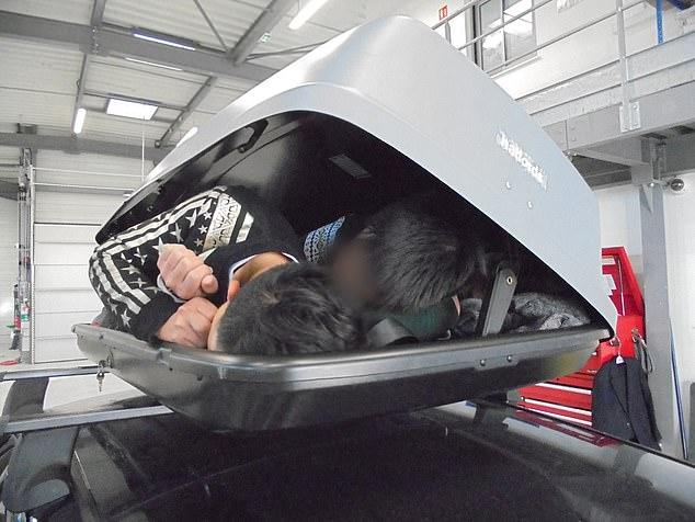 Three Vietnamese migrants were crammed into the car roof box (Picture: Home Office)