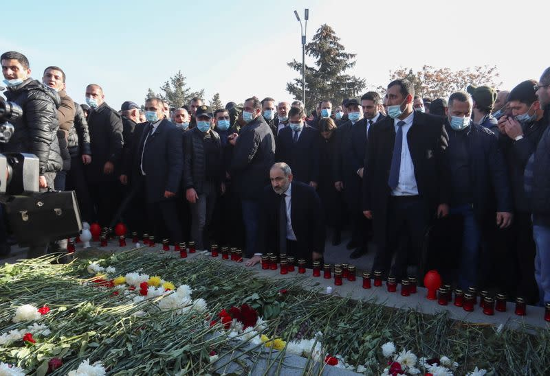 Armenian Prime Minister Pashinyan visits a military cemetery on the day of nationwide mourning in Yerevan