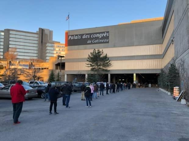 People line up outside the Palais des Congrès de Gatineau April 8, 202, the first day Quebec allowed walk-in vaccine appointments for people age 55 and above. This is the only location offering this in the Outaouais.