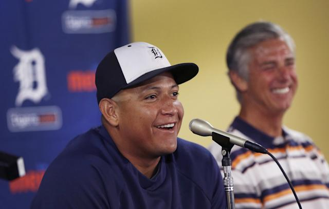 Detroit Tigers first baseman Miguel Cabrera shares a laugh with Tigers President, CEO and General Manager David Dombrowski during a news conference where the details of Cabrera's eight-year contract extension was officially announced in Lakeland, Fla., Friday, March 28, 2014. (AP Photo/Carlos Osorio)