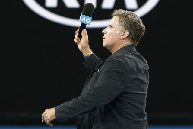 Tennis - Australian Open - Rod Laver Arena, Melbourne, Australia, January 16, 2018. Actor Will Ferrell waves his microphone after speaking to Roger Federer of Switzerland following Federer's win against Aljaz Bedene of Slovenia. REUTERS/Thomas Peter