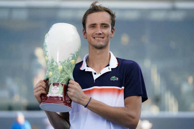 Daniil Medvedev, of Russia, holds the Rookwood Cup after defeating David Goffin, of Belgium, in the men's final match during the Western & Southern Open tennis tournament Sunday, Aug. 18, 2019, in Mason, Ohio. (AP Photo/John Minchillo)