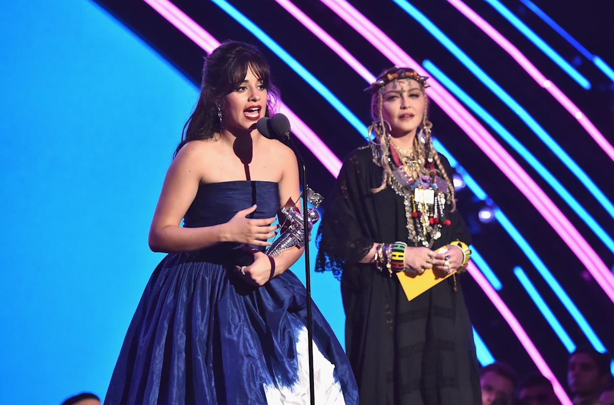 NEW YORK, NY - AUGUST 20: Camila Cabello accepts the award for Video of the Year from Madonna onstage during the 2018 MTV Video Music Awards at Radio City Music Hall on August 20, 2018 in New York City. (Photo by Kevin Mazur/WireImage)