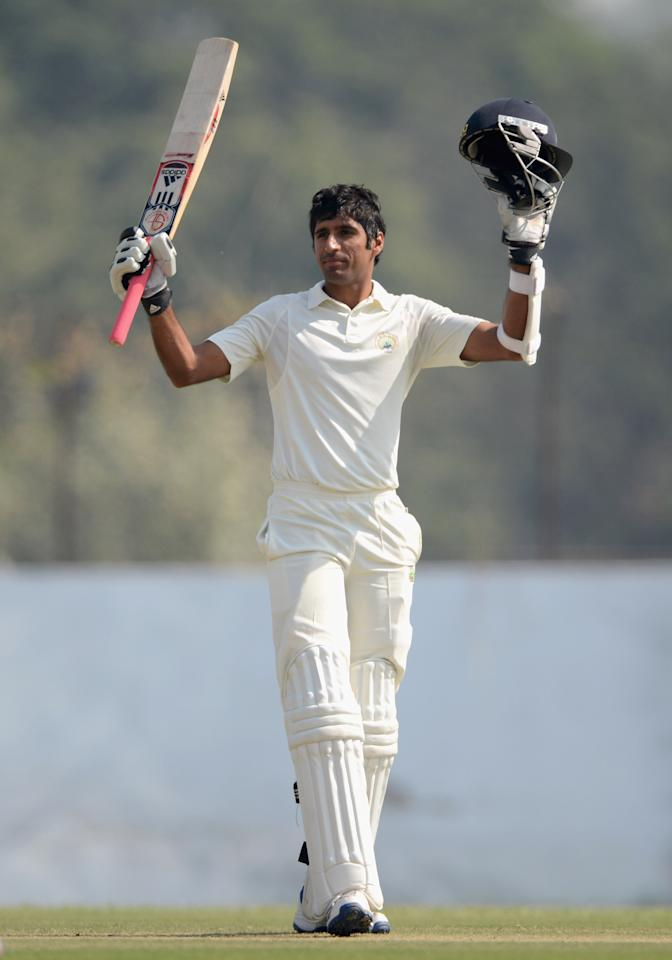 AHMEDABAD, INDIA - NOVEMBER 10:  Rahul Dewan of Haryana celebrates reaching his century during day three of the tour match between England and Haryana at Sardar Patel Stadium ground B on November 10, 2012 in Ahmedabad, India.  (Photo by Gareth Copley/Getty Images)