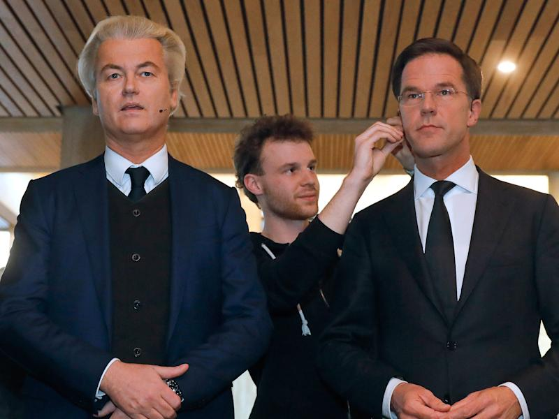 Geert Wilders and Mark Rutte get their microphones installed before the televised debate: AP