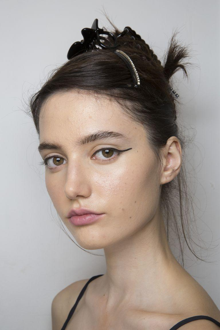 <p>Sometimes all you really need is a sharp liner wing, as seen at Marco de Vincenzo.</p>