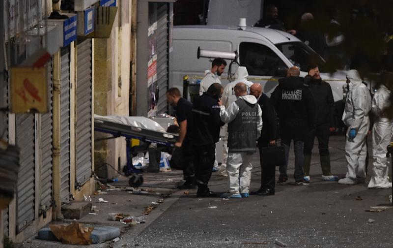 A body is removed from the apartment raided by French Police special forces in the northern Paris suburb of Saint-Denis, on November 18, 2015