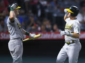 Oakland Athletics' Sean Murphy, left, congratulates Matt Chapman after Chapman hit a solo home run during the eighth inning of the team's baseball against the Los Angeles Angels on Friday, July 30, 2021, in Anaheim, Calif. (AP Photo/John McCoy)