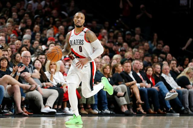 "<a class=""link rapid-noclick-resp"" href=""/nba/players/5012/"" data-ylk=""slk:Damian Lillard"">Damian Lillard</a> reportedly suffered a rib injury during Game 2 of the Western Conference Finals. (Photo by Jonathan Ferrey/Getty Images)"