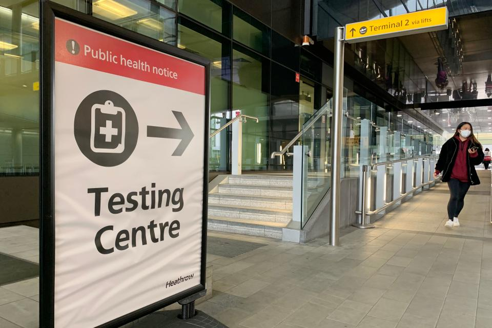 A sign points the way for a Covid-19 testing centre at Terminal 2 in at London Heathrow Airport in west London, on January 18, 2021. - All arrivals to the UK will have to quarantine and show negative tests for Covid-19 from today at 0400 GMT, after the government scrapped