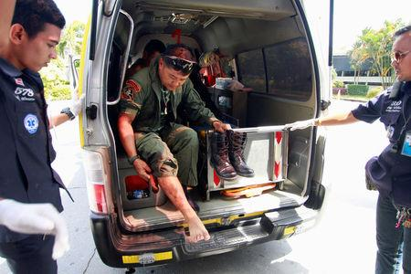 An injured Thai military personnel arrives at a hospital after a roadside bomb blast in the southern Malay Muslim province of Yala, Thailand September 14, 2017. REUTERS/Surapan Boonthanom