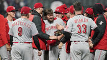 Cincinnati Reds starting pitcher Wade Miley, center, is congratulated by teammates after he pitched a no-hitter in a baseball game against the Cleveland Indians, Friday, May 7, 2021, in Cleveland. (AP Photo/Tony Dejak)