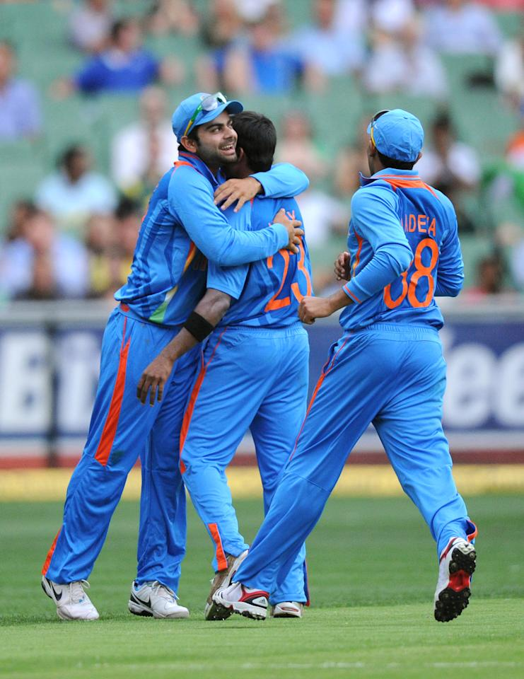 India's Ranganath Vinay Kumar, center, celebrates with a teammates after taking the wicket of Australia's Ricky Ponting during their one cay international cricket match at the MCG in Melbourne, Australia, Sunday, Feb. 5, 2012. (AP Photo/Mal Fairclough)