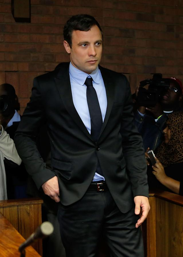 PRETORIA, SOUTH AFRICA - AUGUST 19: South African athlete Oscar Pistorius appears in Pretoria Magistrates Court for an indictment hearing on August 19, 2013 in Pretoria, South Africa. Pistorius, 26 is accused of murdering his girlfriend Reeva Steenkamp which Pistorius denies claiming he mistook Steenkamp for an intruder. The indictment was served and the trial date of March 3, 2014 has now been set. (Photo by Jemal Countess/Getty Images)