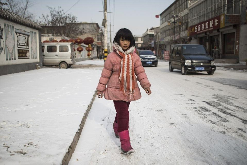 "A girl leaves her school at Tuntou village, on the outskirts of Shijiazhuang, Hebei province. Style-conscious Chinese youth are shedding long johns in the belief they are ""tasteless"" and ""old-fashioned"". Photo: AFP"