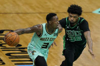 Charlotte Hornets guard Terry Rozier drives to the basket past Boston Celtics guard Marcus Smart during the first half of an NBA basketball game on Sunday, April 25, 2021, in Charlotte, N.C. (AP Photo/Chris Carlson)
