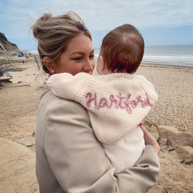 <p>The new mama can't get enough of her little girl, who's rocking the cutest embroidered sweater.</p>