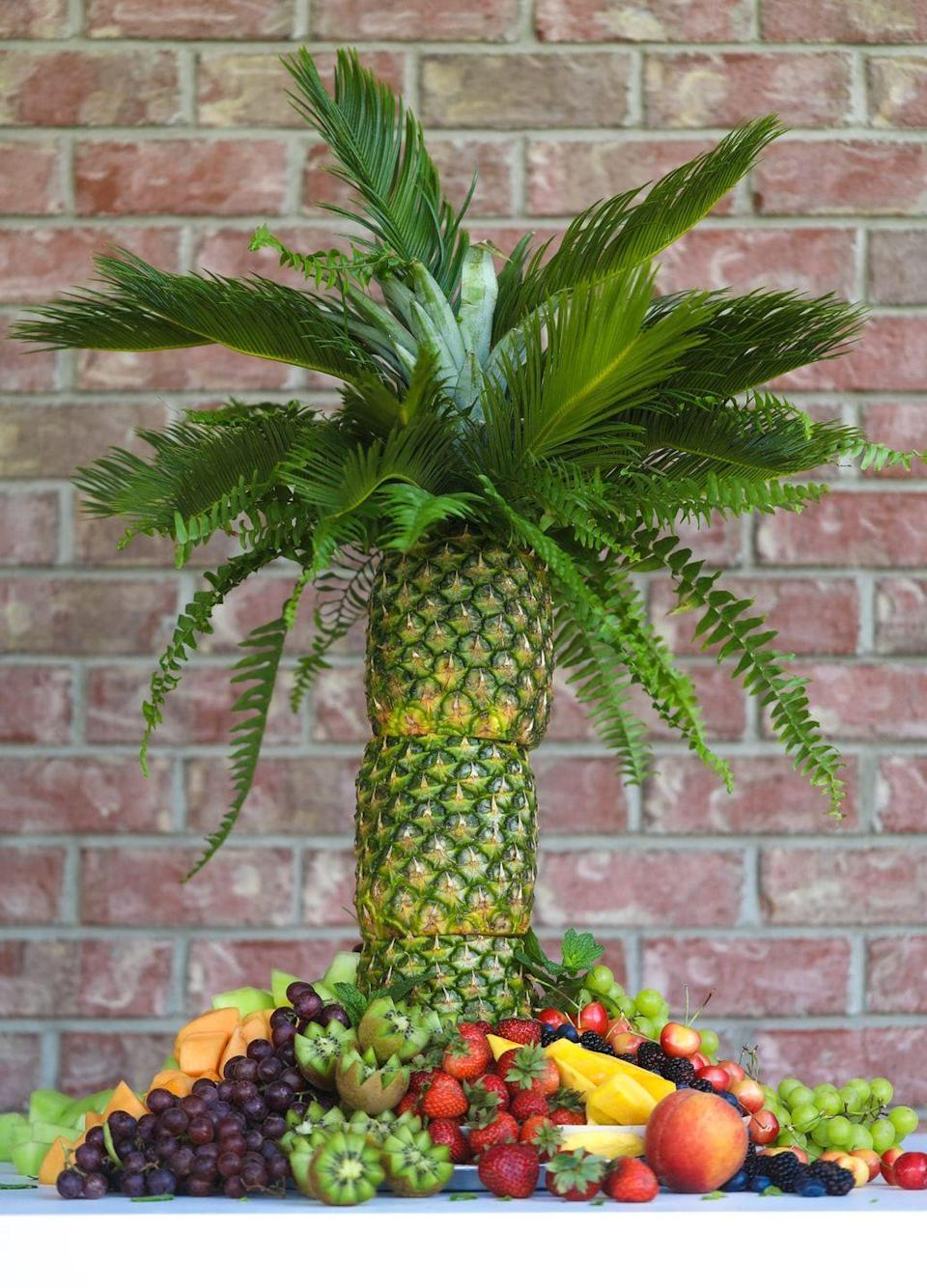 """<p>With this at the center of your buffet, one thing's for sure: Your family and friends have never seen barbecue food served like this. </p><p><a class=""""link rapid-noclick-resp"""" href=""""https://www.howsweeteats.com/2019/06/pineapple-palm-tree/"""" rel=""""nofollow noopener"""" target=""""_blank"""" data-ylk=""""slk:GET THE RECIPE"""">GET THE RECIPE</a></p><p><a class=""""link rapid-noclick-resp"""" href=""""https://www.amazon.com/Maitys-Floral-Support-Wooden-Natural/dp/B07S2J9ZYM/ref=sr_1_32?dchild=1&keywords=garden+stakes&qid=1591630936&sr=8-32&tag=syn-yahoo-20&ascsubtag=%5Bartid%7C10072.g.32715018%5Bsrc%7Cyahoo-us"""" rel=""""nofollow noopener"""" target=""""_blank"""" data-ylk=""""slk:SHOP STAKES"""">SHOP STAKES</a></p>"""