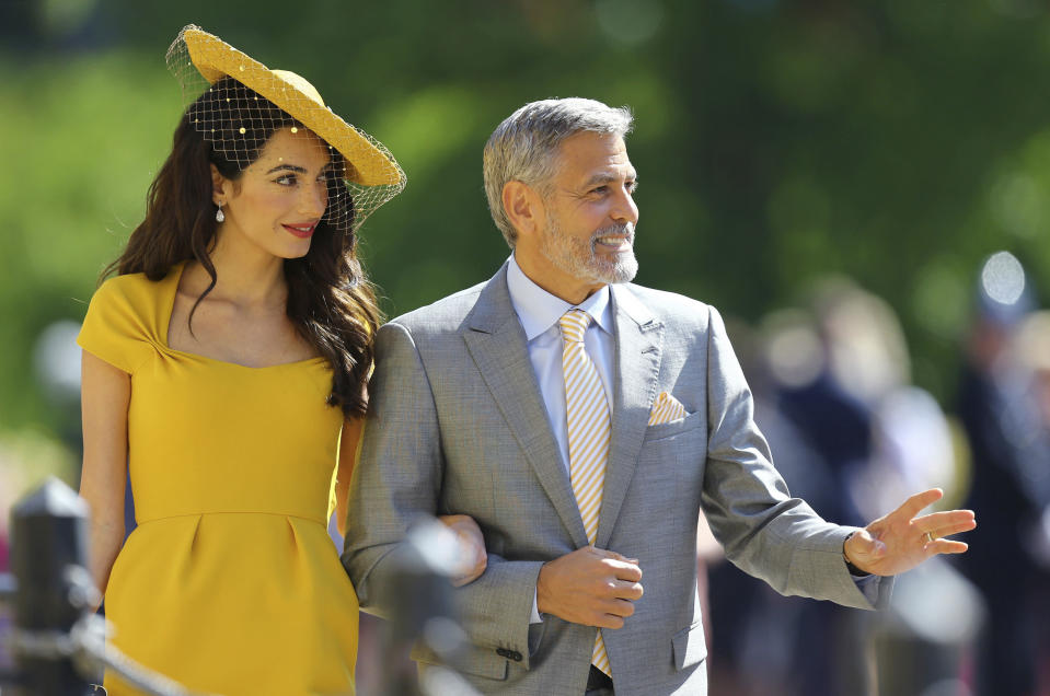 Amal Clooney and George Clooney arrive for the wedding ceremony of Prince Harry and Meghan.