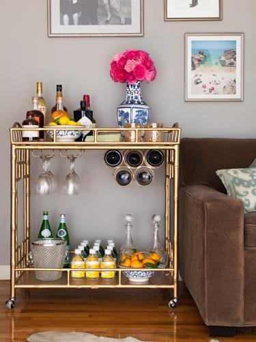 """<div class=""""caption-credit"""">Photo by: Stephanie Stanley</div><div class=""""caption-title"""">Getting carted</div>Why all the sudden interest in home bar carts? """"There has been a trend toward formality in home entertaining,"""" explains Gibbons. """"The retro tradition of the cocktail hour is making a comeback, and a bar cart makes for a chic way to present everything."""" Putting together a home bar is way easier than it looks. """"Choose something that can do double-duty,"""" says Gibbons, who styled this gold stunner in her home in Harlem, NY. """"This double-stand cart fits in next to my couch and also functions as a side table."""" <ul> <li> <b><a rel=""""nofollow noopener"""" href=""""http://www.redbookmag.com/recipes-home/tips-advice/party-food-recipes?link=relt&dom=yah_life&src=syn&con=blog_redbook&mag=rbk"""" target=""""_blank"""" data-ylk=""""slk:The 30 Best Party Foods of All Time"""" class=""""link rapid-noclick-resp"""">The 30 Best Party Foods of All Time</a></b> </li> <li> <a rel=""""nofollow noopener"""" href=""""http://www.redbookmag.com/recipes-home/tips-advice/classic-cocktails?link=relt&dom=yah_life&src=syn&con=blog_redbook&mag=rbk"""" target=""""_blank"""" data-ylk=""""slk:6 Classic Cocktails to Sip Now"""" class=""""link rapid-noclick-resp""""><b>6 Classic Cocktails to Sip Now</b> <br></a> </li> </ul>"""