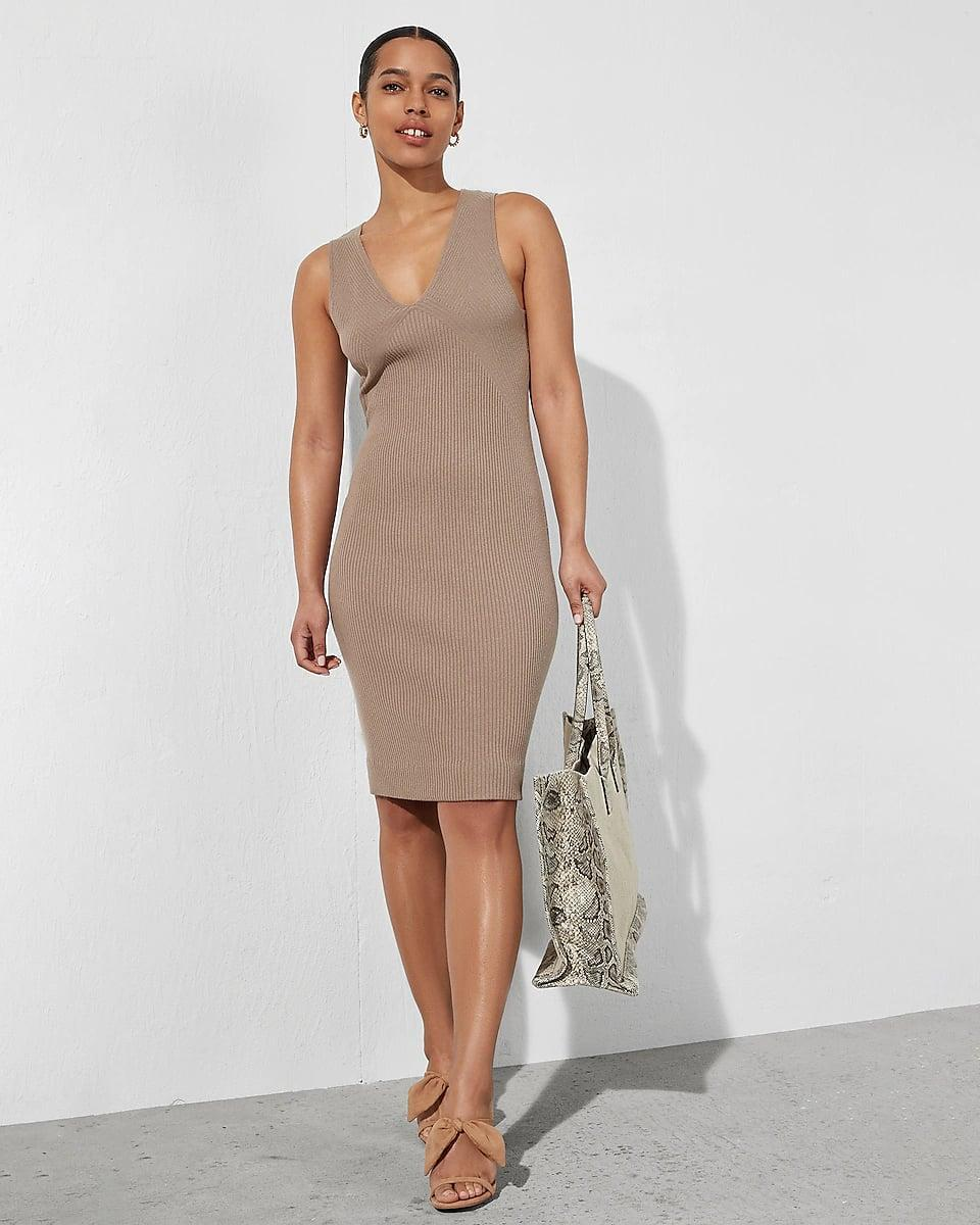 <p>This <span>Express Sleeveless Ribbed Midi Sweater Dress</span> ($78) is as chic as it is easy to wear. We love the ribbed fabric and the muted color palette for an elegant and endlessly wearable look.</p>