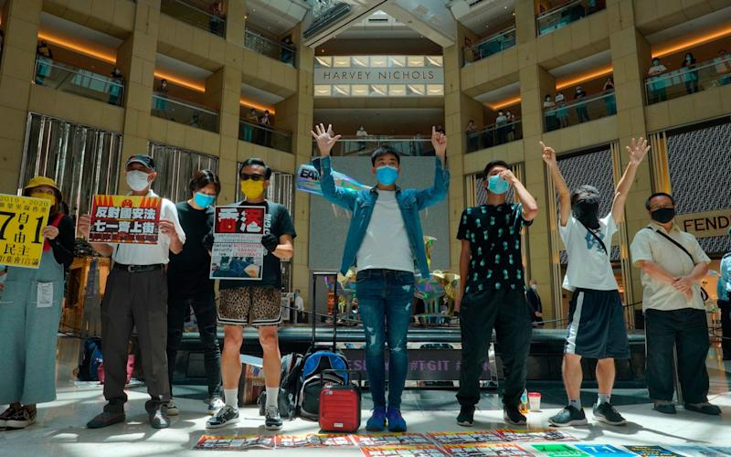 Protesters gather at a shopping mall in Central during a pro-democracy protest against Beijing's national security law in Hong Kong - Vincent Yu/AP