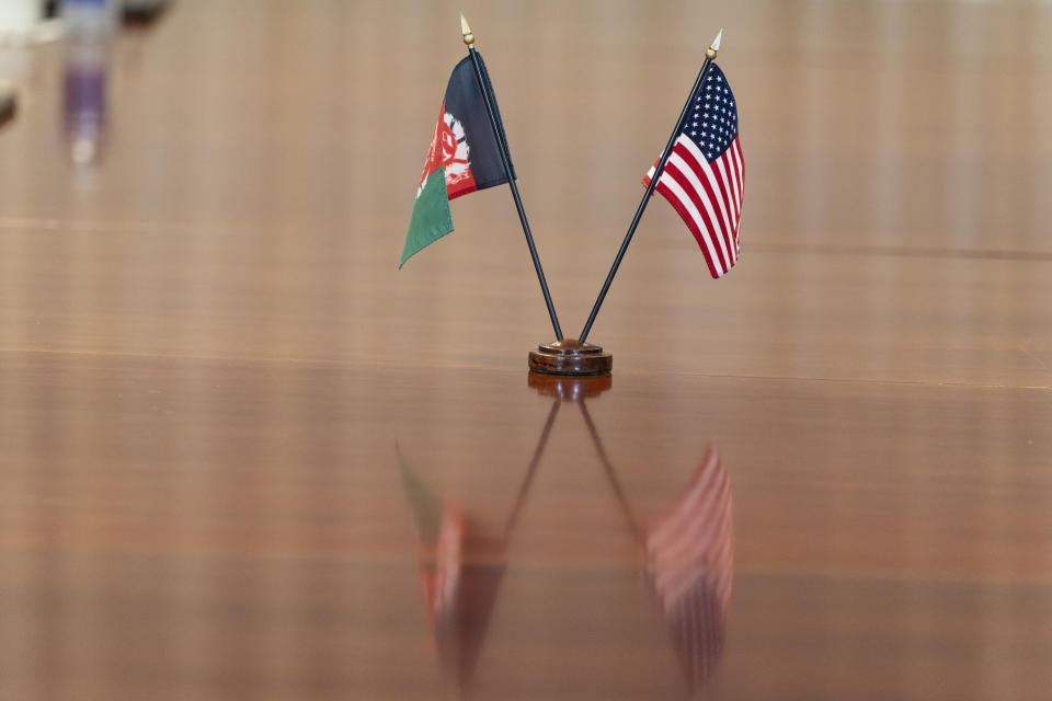 The flags of Afghanistan and the United States are seen on the table before a meeting between the Secretary of Defense Lloyd Austin and Afghan President Ashraf Ghani at the Pentagon in Washington, Friday, June 25, 2021. (AP Photo/Alex Brandon)