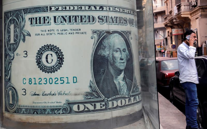 Dollar gains on Fed rates view, stocks falter