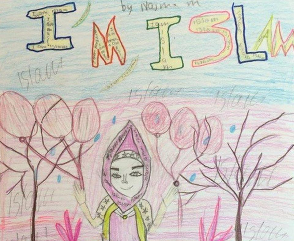 """An artwork produced by one of the children of Cedar-Riverside neighbourhood, saying """"I am Islam"""" and showing the photo of the girl in a hijab, holding balloons"""