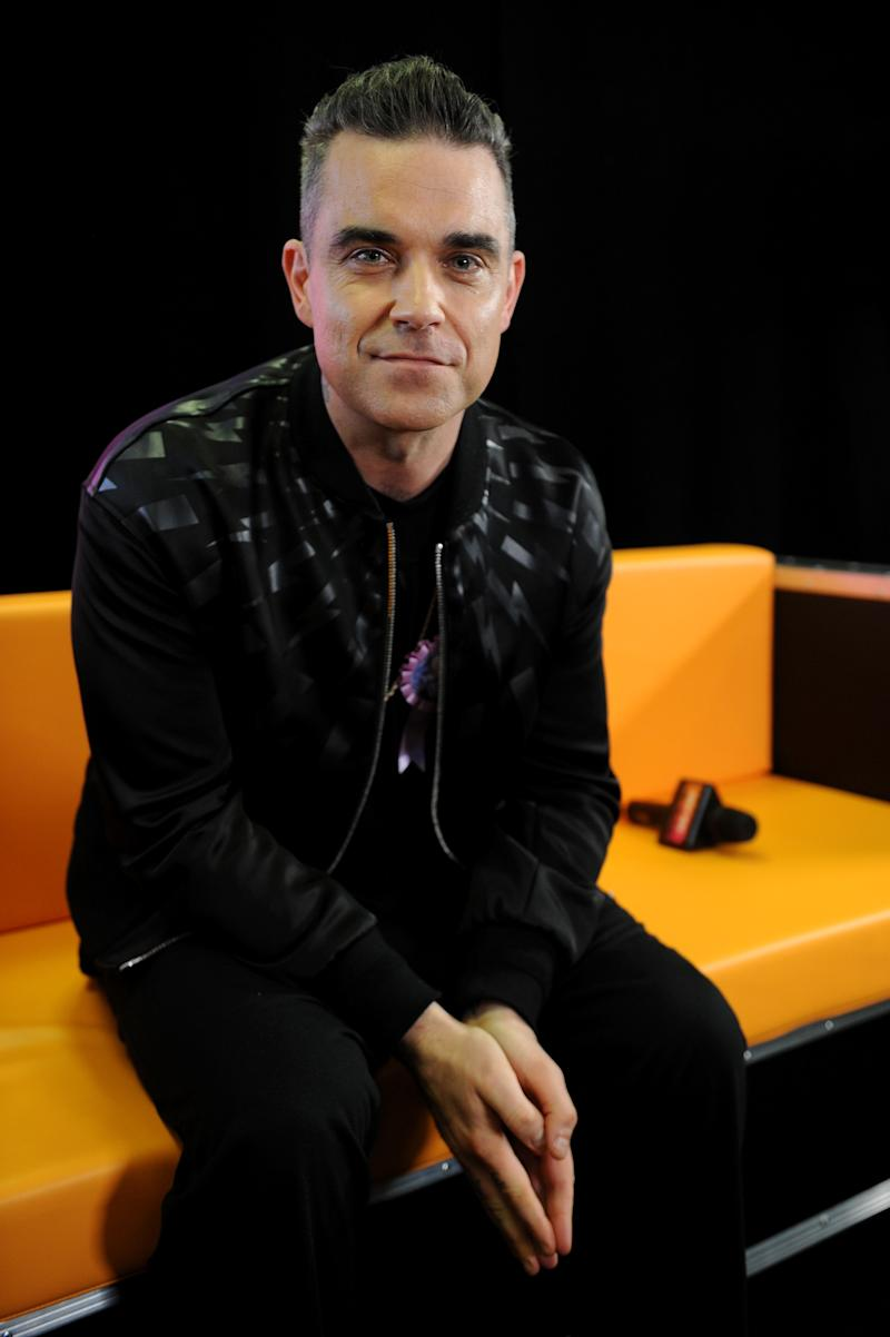 MANCHESTER, ENGLAND - DECEMBER 09: Robbie Williams poses backstage at Key 103 Christmas Live at Manchester Arena on December 9, 2016 in Manchester, England. (Photo by Shirlaine Forrest/Getty Images)
