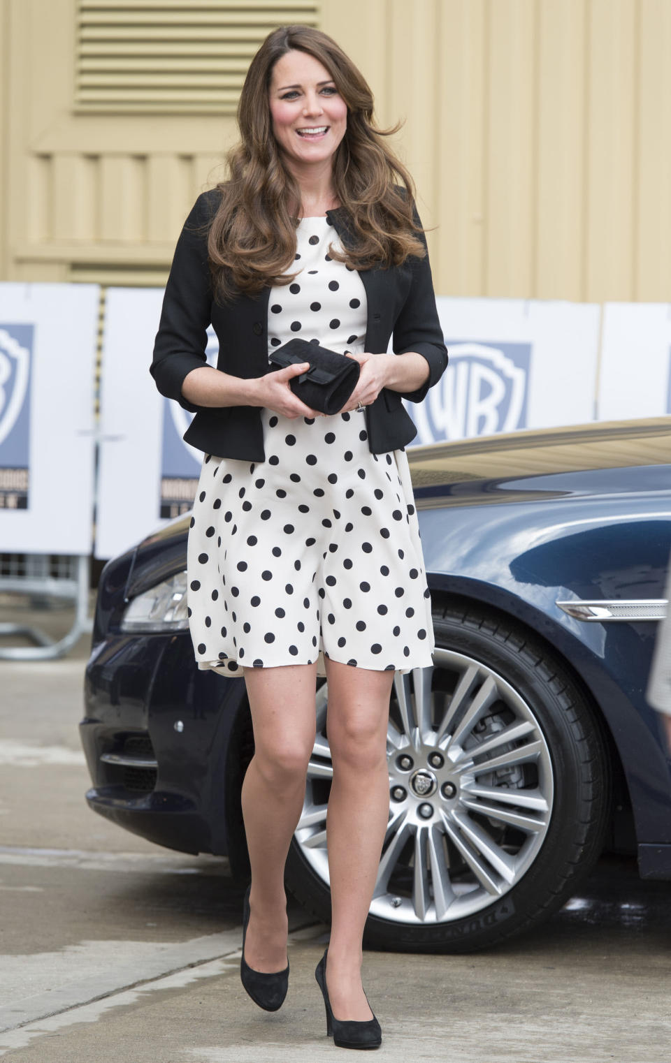 <p>Kate visited the Warner Bros. studios in April 2013 in a polka-dot dress by Topshop. She accessorised the look with co-ordinating monochrome accessories. <em>[Photo: Getty]</em> </p>