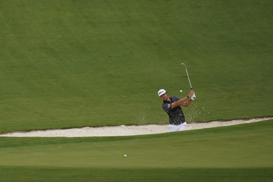 FILE - In this Nov. 10, 2020, file photo, Lanto Griffin hits out of a bunker on the second hole during a practice round for the Masters golf tournament in Augusta, Ga. Griffin says Augusta National will be a different test when he plays in a second time in April. (AP Photo/David J. Phillip, File)