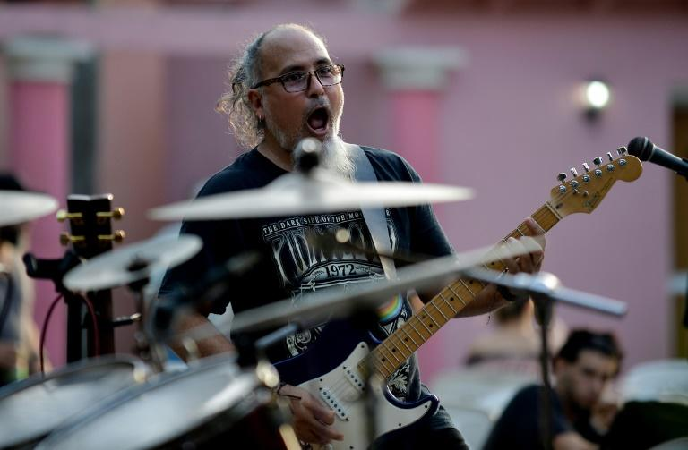 Cuban rock band Vieja Escuela (Old School) is seen here performin in Havana -- a concert that was once unthinkable during the height of Fidel Castro's revolution (AFP Photo/YAMIL LAGE)