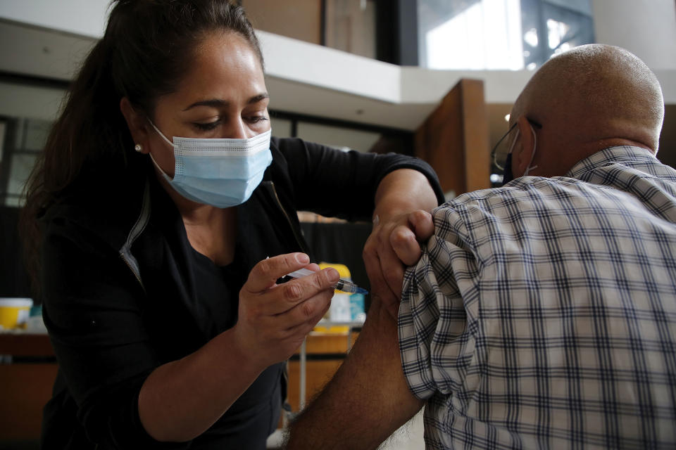 SANTIAGO, CHILE - MARCH 19: A health worker vaccinates a citizen over 60 years old on March 19, 2021 in Santiago, Chile. The Andean country already inoculated over 5.5 million people, which represents 18% of its population.  (Photo by Marcelo Hernandez/Getty Images)