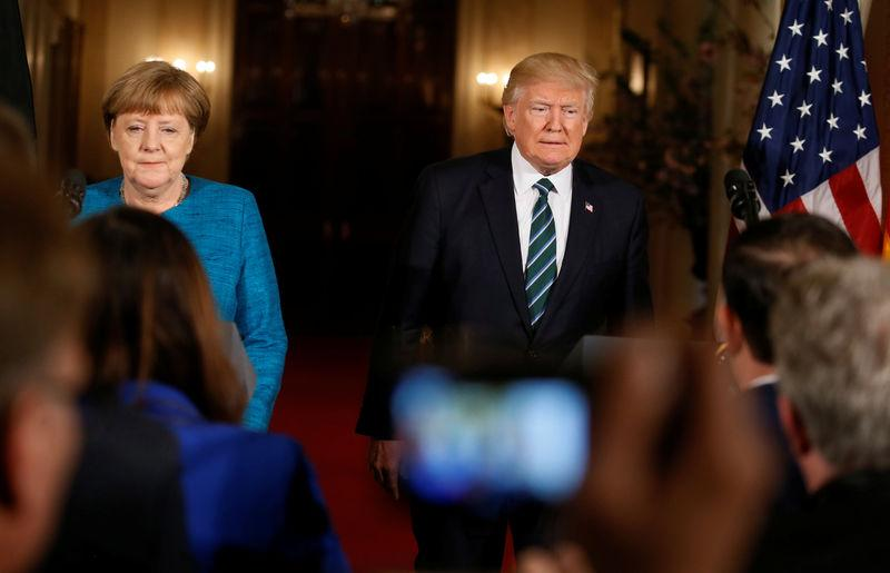 U.S. President Trump and German Chancellor Merkel arrive at a joint news conference in Washington