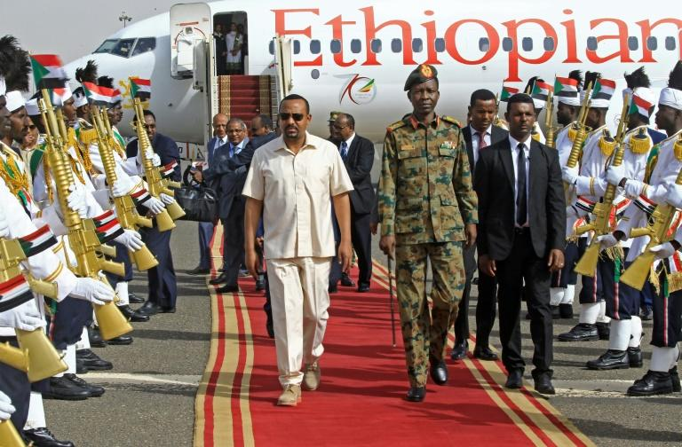 Ethiopia's Prime Minister Abiy Ahmed (C-L) hopes the election will give him the mandate to make broad reforms