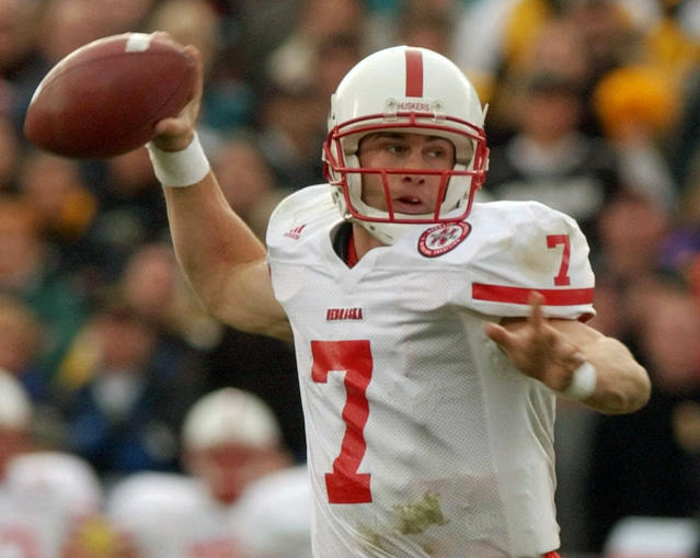 FILE - In this Nov. 23, 2001, file photo, Nebraska quarterback Eric Crouch rolls out to pass during the third quarter against Colorado in a Big-12 NCAA college football game in Boulder, Colo. A glance at the list of candidates eligible for selection to the College Football Hall of Fame is likely to produce the following reaction: How is that guy not in yet? Heisman Trophy winners Rashaan Salaam, Carson Palmer and Crouch are still waiting. (AP Photo/David Zalubowski, File)