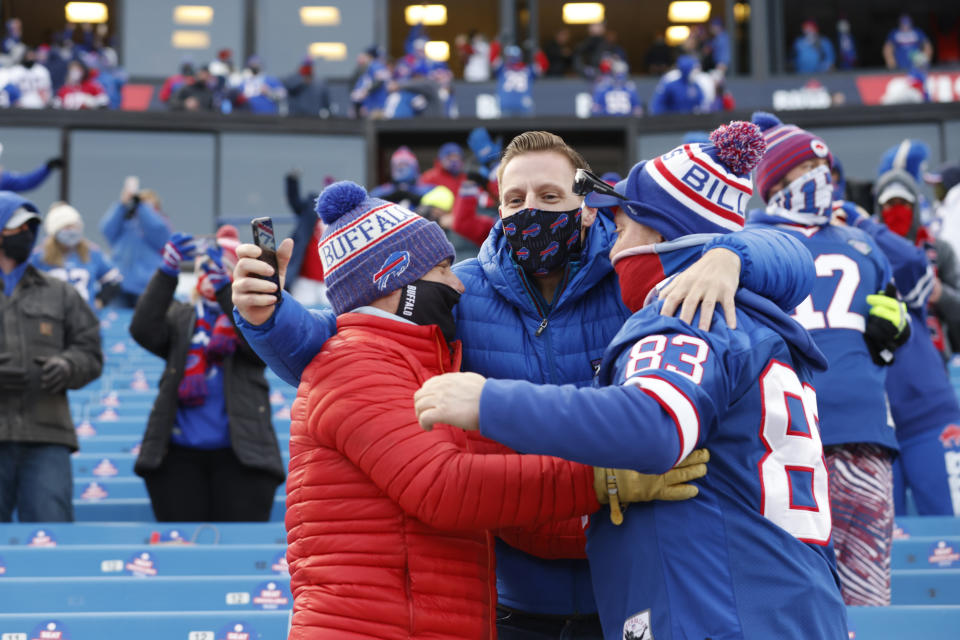 Fans celebrate after the Buffalo Bills beat the Colts 27-24 in a wild-card playoff game. (Photo by Bryan M. Bennett/Getty Images)