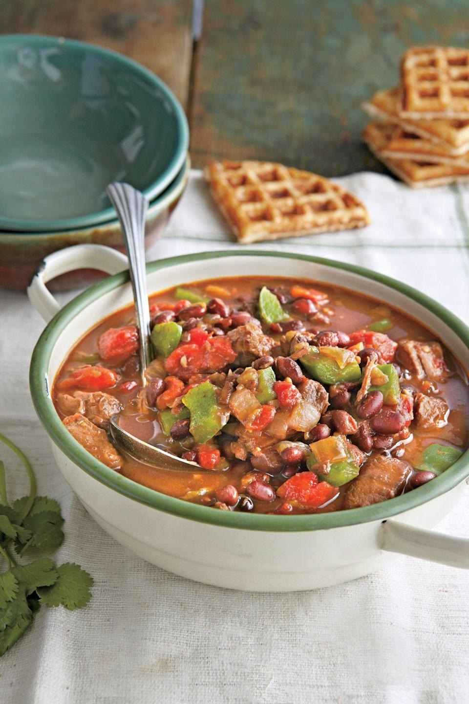 """<p><strong>Recipe: <a href=""""http://www.myrecipes.com/recipe/spicy-steak-black-bean-chili"""" rel=""""nofollow noopener"""" target=""""_blank"""" data-ylk=""""slk:Spicy Steak and Black Bean Chili"""" class=""""link rapid-noclick-resp"""">Spicy Steak and Black Bean Chili</a></strong></p> <p>Easy Side: Prepare batter from 2 (6-oz.) packages buttermilk cornbread mix according to package directions. Cook batter, in batches, in a preheated, oiled waffle iron until done.</p>"""
