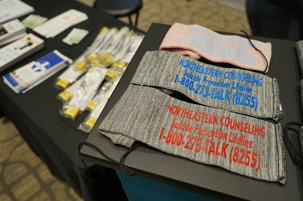 The Northeastern Counseling Center distributed gun socks screen-printed with the National Suicide Prevention Lifeline information at the Vernal Gun & Knife Show in Vernal, Utah. Utah has one of the highest rates of suicide in the U.S. (Erik Neumann/KUER)