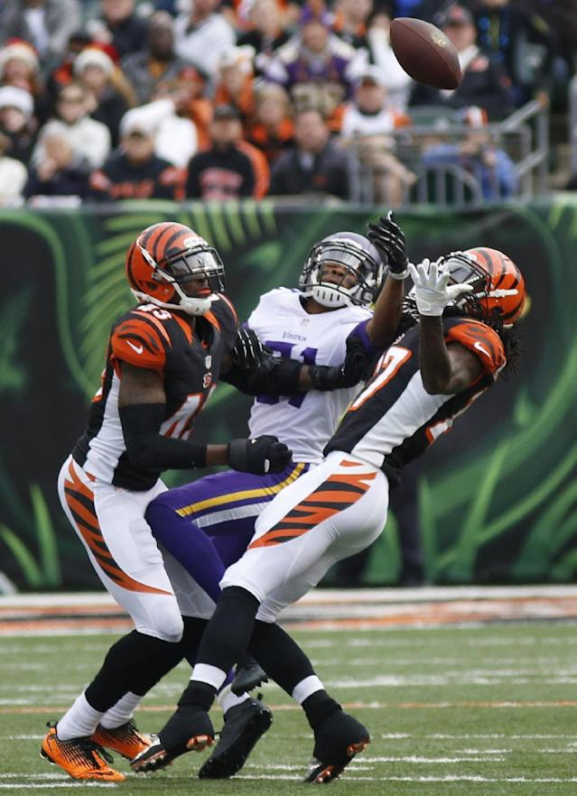 Cincinnati Bengals strong safety George Iloka (43) and cornerback Dre Kirkpatrick (27) break up a pass intended for Minnesota Vikings wide receiver Jerome Simpson during the second half of an NFL football game, Sunday, Dec. 22, 2013, in Cincinnati. Iloka intercepted the pass. (AP Photo/David Kohl)