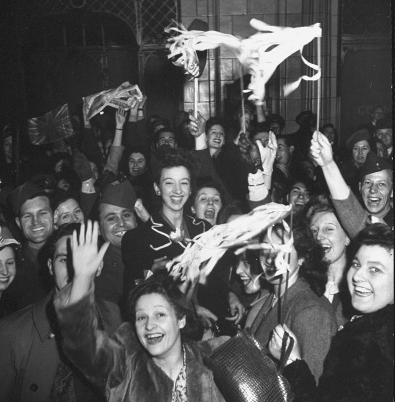 Londoners and Allied soldiers hold spontaneous celebration on eve of VE Day in Piccadilly, London, England, May 7, 1945. (Photo by Bob Landry/The LIFE Picture Collection via Getty Images)