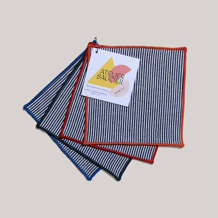 """Save your surfaces from rings left from wet glasses with these striped cocktails napkins. Better yet, they're made of 100% reclaimed deadstock fabric. $28, Goldune. <a href=""""https://www.goldune.com/collections/kitchen/products/americana-stripe-cocktails"""" rel=""""nofollow noopener"""" target=""""_blank"""" data-ylk=""""slk:Get it now!"""" class=""""link rapid-noclick-resp"""">Get it now!</a>"""