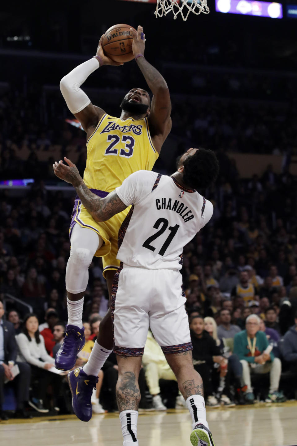 Los Angeles Lakers' LeBron James (23) shoots over Brooklyn Nets' Wilson Chandler (21) during the first half of an NBA basketball game Tuesday, March 10, 2020, in Los Angeles. (AP Photo/Marcio Jose Sanchez)