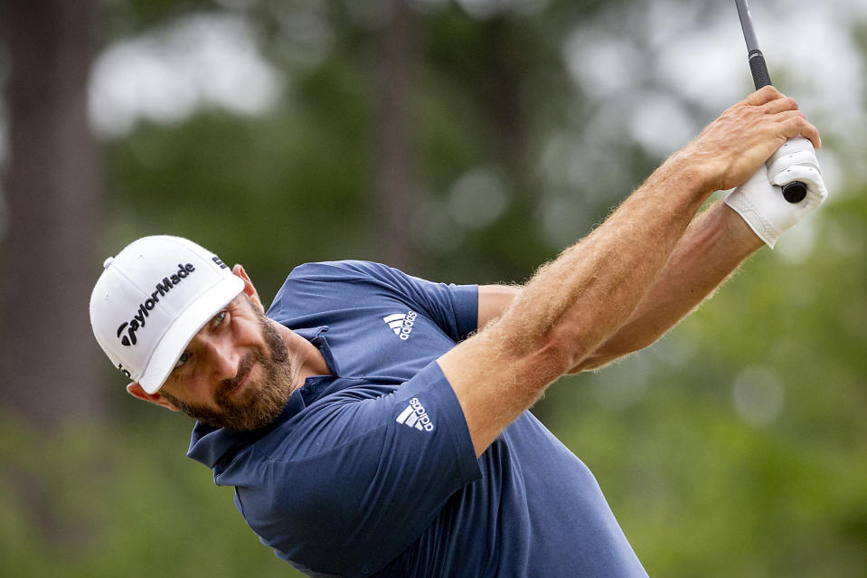 Dustin Johnson watches his drive off the third tee during the final round of the Palmetto Championship golf tournament in Ridgeland, S.C., Sunday, June 13, 2021. (AP Photo/Stephen B. Morton)