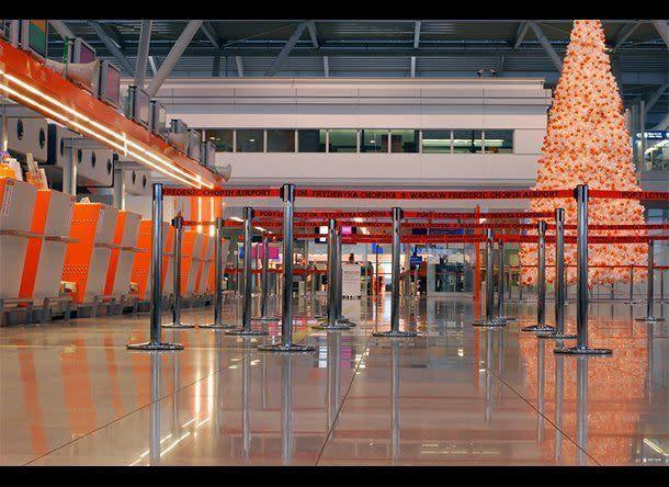 "The airport game is different during the holiday travel season. The tips and tricks you usually employ over the course of the year may not work so well between Thanksgiving and Christmas. This year, don't be the turkey who misses his flight or holds up security. Be the pro who navigates the crowded airport with skill and grace instead. Here's how to do it. <br><br> <strong>More from SmarterTravel:</strong> <a href=""http://www.smartertravel.com/photo-galleries/editorial/nine-tips-for-surviving-the-middle-seat.html?id=417"" rel=""nofollow noopener"" target=""_blank"" data-ylk=""slk:How to Survive the Middle Seat"" class=""link rapid-noclick-resp"">How to Survive the Middle Seat</a> <a href=""http://www.smartertravel.com/travel-advice/photos/pro-tips-for-flying-in-comfort.html?id=26347227"" rel=""nofollow noopener"" target=""_blank"" data-ylk=""slk:Pro Tips for Flying in Comfort"" class=""link rapid-noclick-resp"">Pro Tips for Flying in Comfort</a> <a href=""http://www.smartertravel.com/travel-advice/photos/the-15-items-you-need-to-survive-long-haul-flight.html?id=26094514"" rel=""nofollow noopener"" target=""_blank"" data-ylk=""slk:The 15 Items You Need to Survive a Long-Haul Flight"" class=""link rapid-noclick-resp"">The 15 Items You Need to Survive a Long-Haul Flight</a> <br><br> (Photo: <a href=""http://www.shutterstock.com/pic-23050846/stock-photo-warsaw-frederic-chopin-terminal-two-interior-christmas-tree-inside.html?src=wMgYeNbNFTOfYJDbSDwO-A-1-2"" rel=""nofollow noopener"" target=""_blank"" data-ylk=""slk:Warsaw Frederic Chopin terminal"" class=""link rapid-noclick-resp"">Warsaw Frederic Chopin terminal</a> via Shutterstock)"